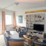 Doppelhaushaelfte-in-Brake-mit-Sonnenterrasse-und-Balkon-Wohnzimmer