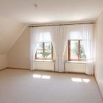 Obergeschosswohnung-Wohnzimmer-mit-Balkon