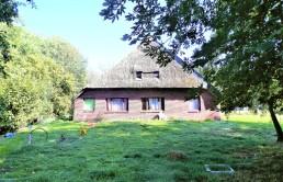 Resthof-in-Brake-mit-grossem-Grundstueck-Suedansicht